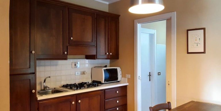 dine-in kitchen with access to living, porch and bathroom